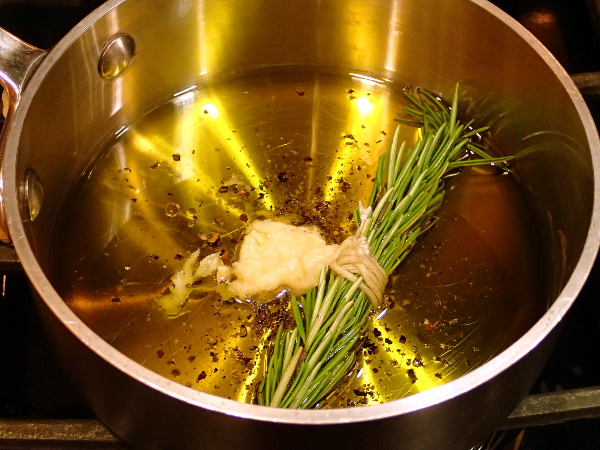 Olive oil, pepper, rosemary and garlic