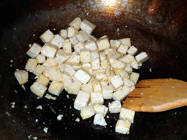 Stir-fry tofu until browned