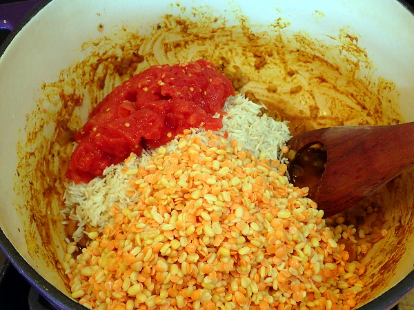 Add basmati rice, red lentils, moon dal and tomatoes